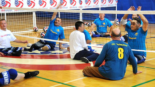 Kazakhstan sitting volleyball athletes go through their first training session with the U.S. Women's national team coach Bill Hamiter.