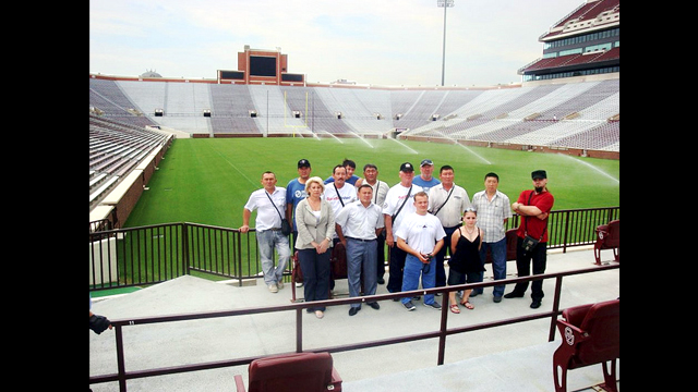 The group tours the football stadium at the University of Oklahoma.