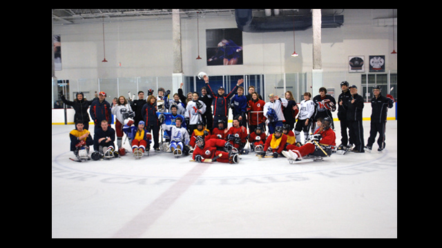 4   The Russian visitors and the hockey sledders pose for a photo after a great scrimmage.