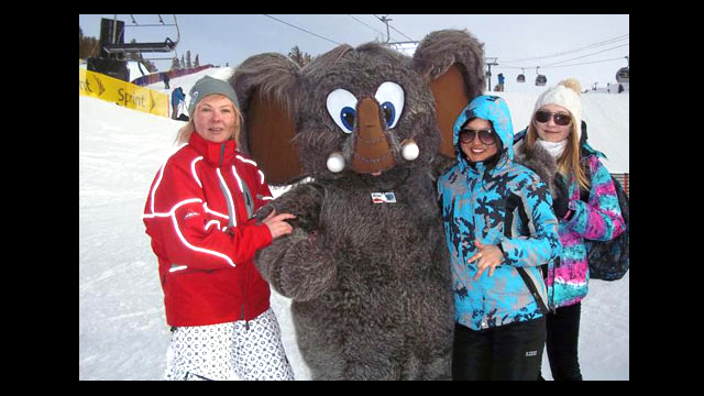 Some of the Sports Visitors greet the Mammoth of Mammoth Mountain during a break from the action at the Slopestyle competition.