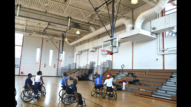 South African basketball players play wheelchair basketball with Mobility International USA.
