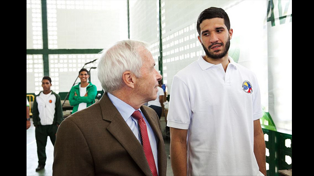 After the opening event, Charges d'Affaires, James Derham, converses with Venezuelan national sports hero, Greivis Vasquez.