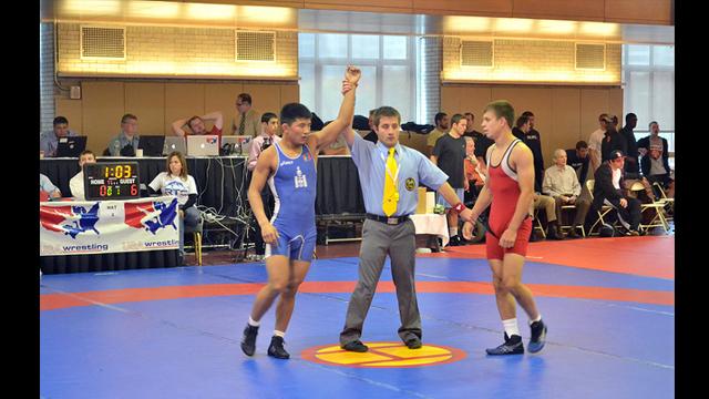 A Mongolian wrestler wins a match.