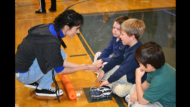 The coaches interact with American students at a local elementary school.