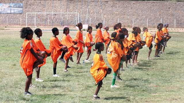 Young Ethiopian girls stretch before their soccer scrimmage in Dire Dawa, Ethiopia.