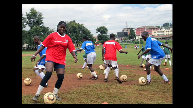 Ugandan soccer coaches practice their dribbling skills at a clinic in Kampala.