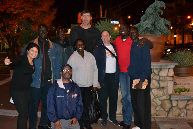 The delegation meets with Gheorghe Muresan, a former NBA player and actor.