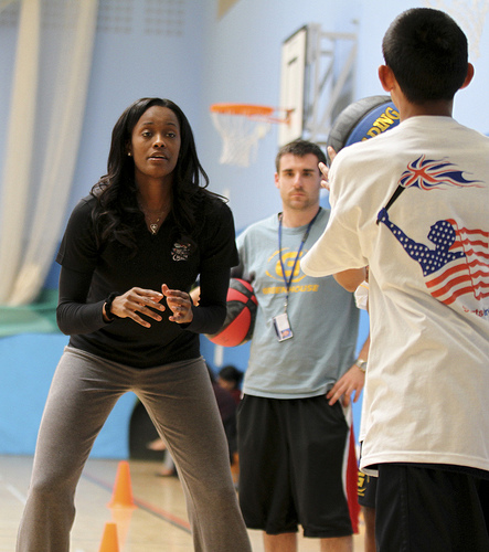 Swin Cash shares her skills through drills with a young player from England.