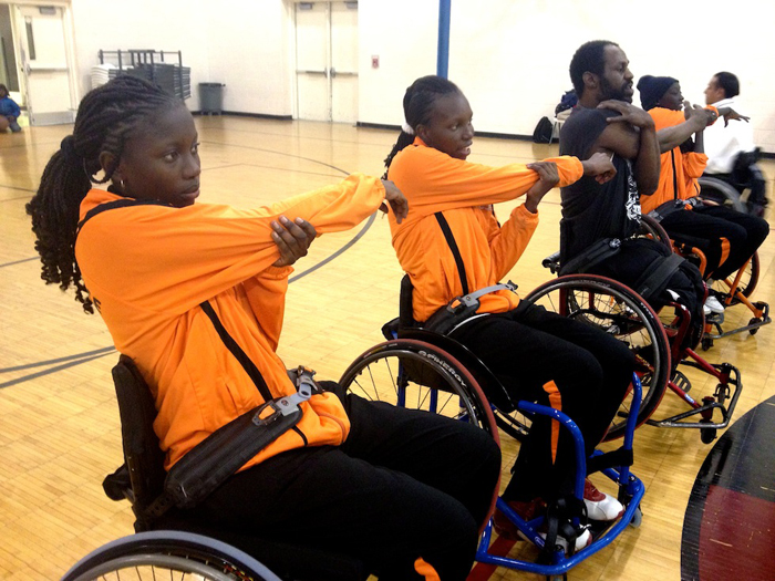 The Senegalese delegation stretches before participating in a disability sport activity with members of a wheelchair basketball league in Washington, D.C.