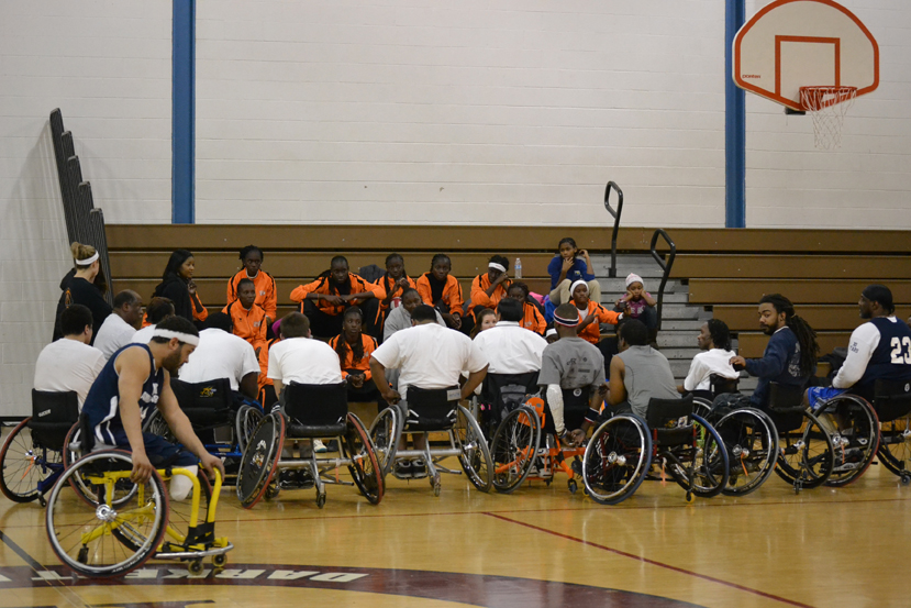 The young women have their first experience playing wheelchair basketball to learn about sports opportunities for people with disabilities.