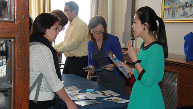 Students discuss Fulbright Program scholarship opportunities with Fulbright alumni and campus advisors during the U.S. Department of State's Exchanges Information Fair at the University of Chicago.