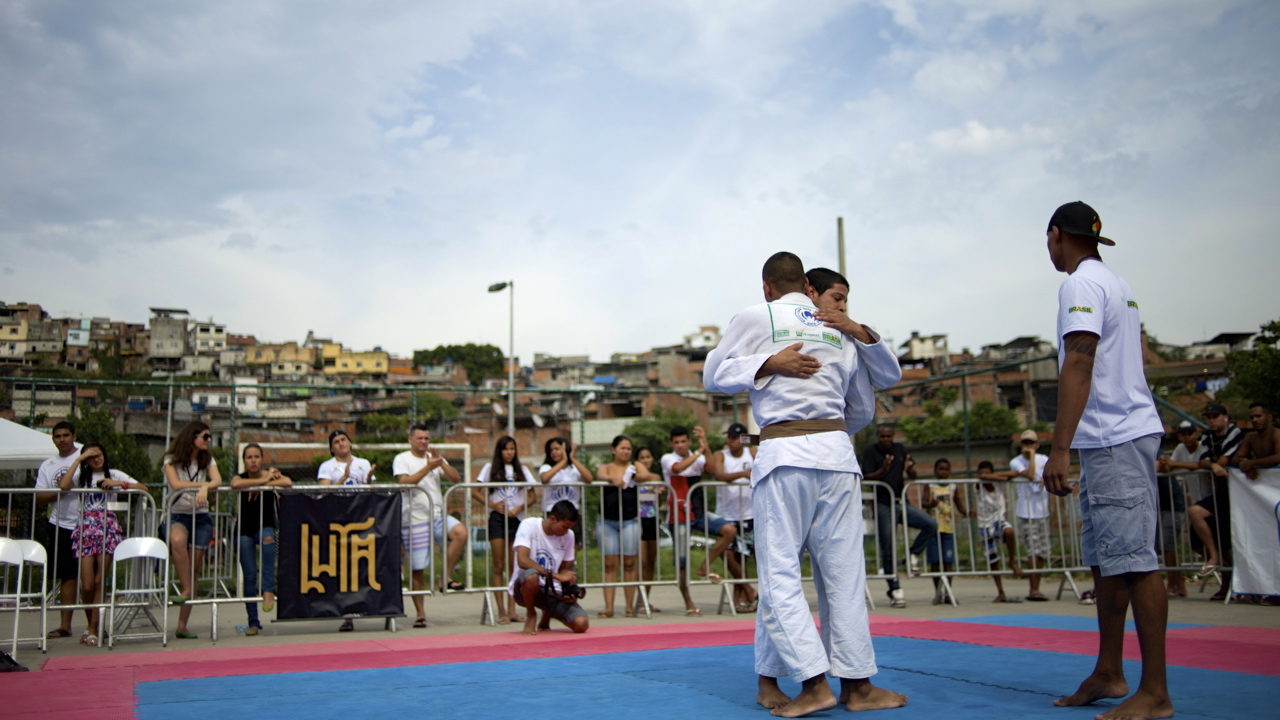 Two Jiu-Jitsu practitioners embrace