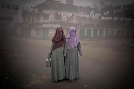 Two young women on their way to work in Comilla