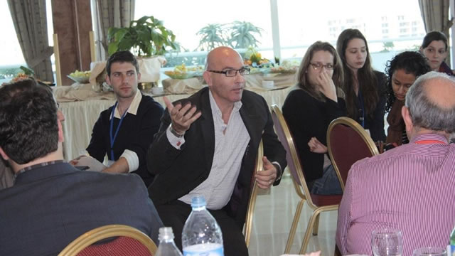 Chairman Tom Healy speaks with Fulbrighters during an enrichment seminar in Rabat, Morocco. His panel remarks touched on the Fulbright Program's role in shaping the future of democracy in Northern Africa.