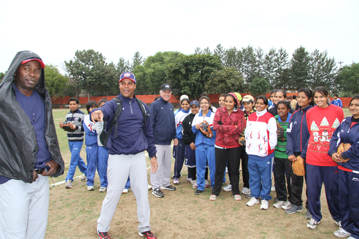 Barry Larkin, Joe Logan, and young athletes in India participate in pre-clinic demonstrations.