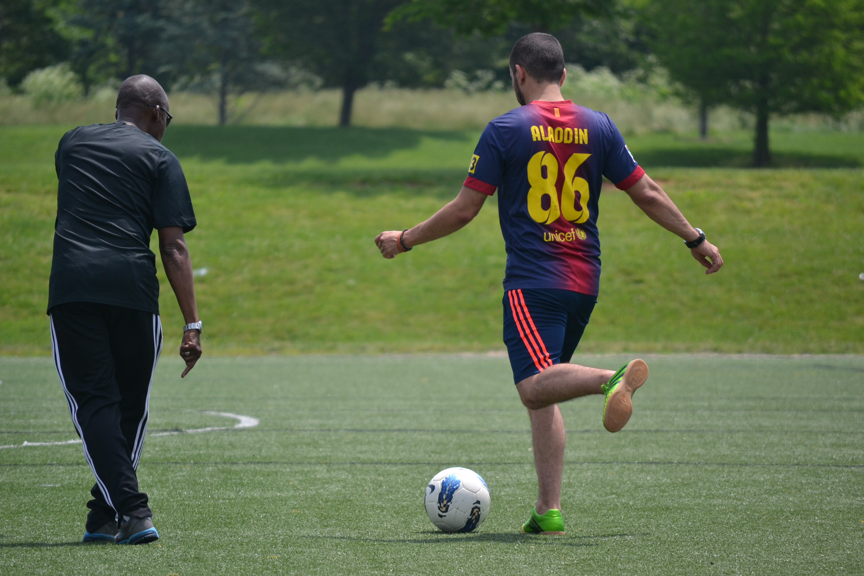 U.S coach/trainer works with a NEA coach on a passing drill.