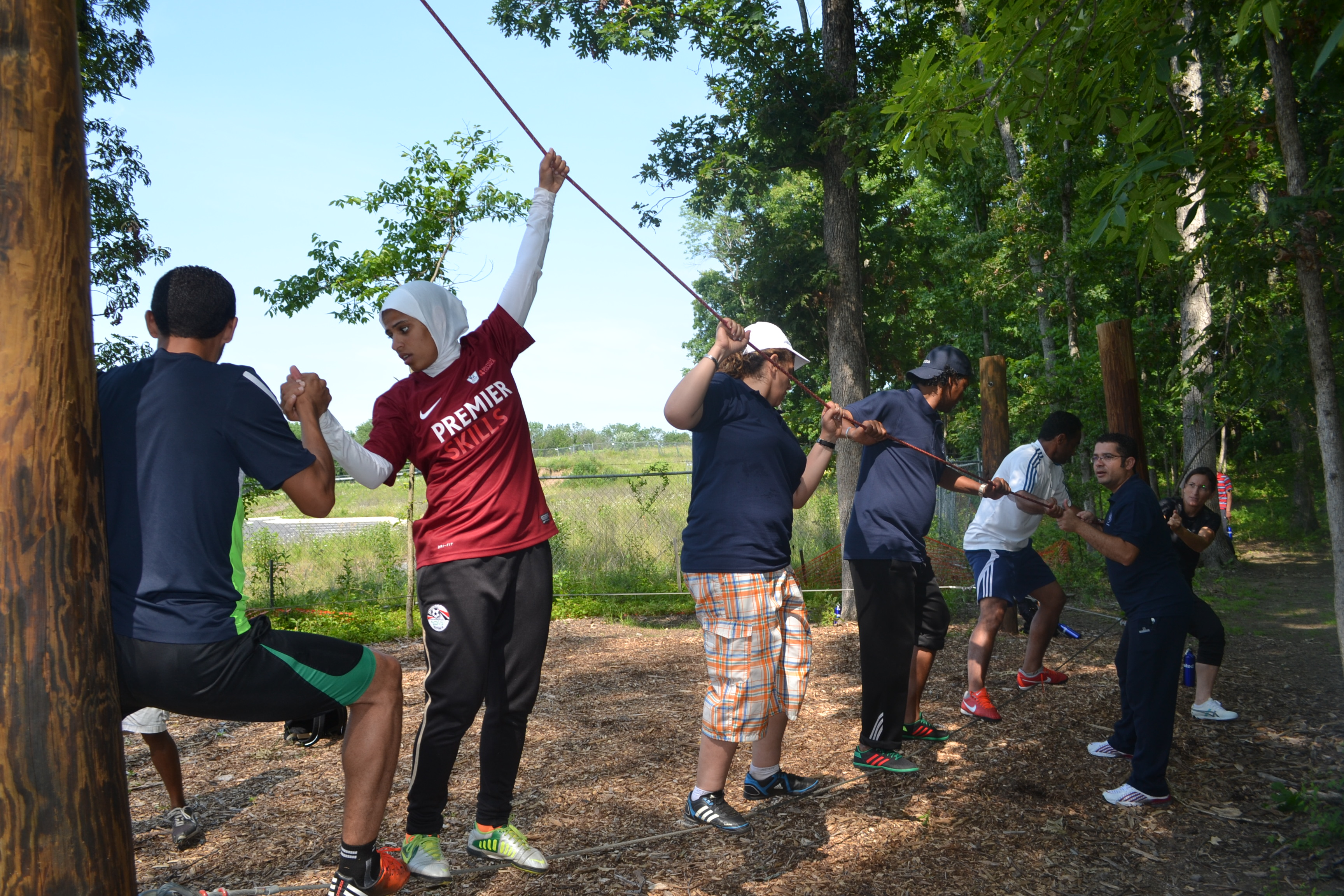 NEA participants worked together to accomplish different challenges at The Edge ropes course.