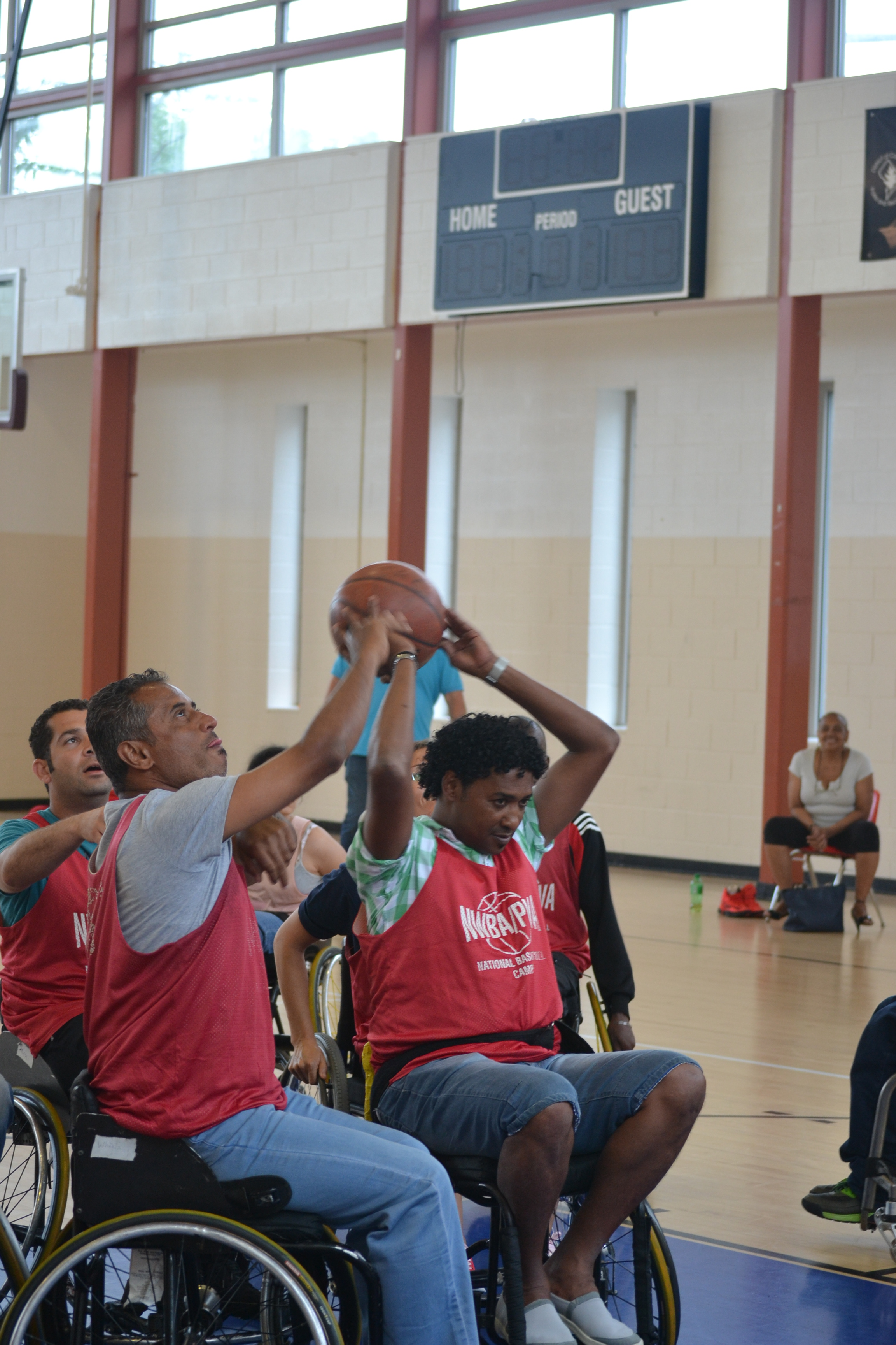 The group tries a new sport, wheelchair basketball, and furthers their teamwork skills at the same time.