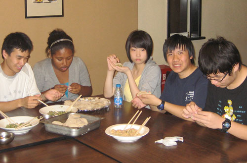 NSLI-Y students from Chicago Public Schools learn to wrap jiaozi (Chinese dumplings) at East China Normal University, Shanghai, China.