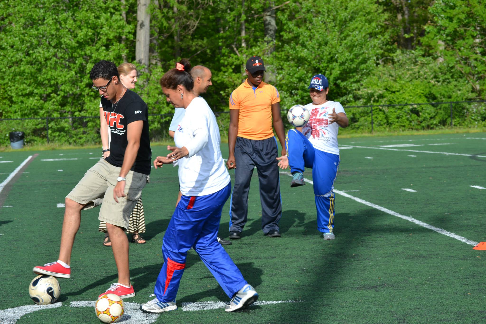 Coaches instructing the sports visitors during drills