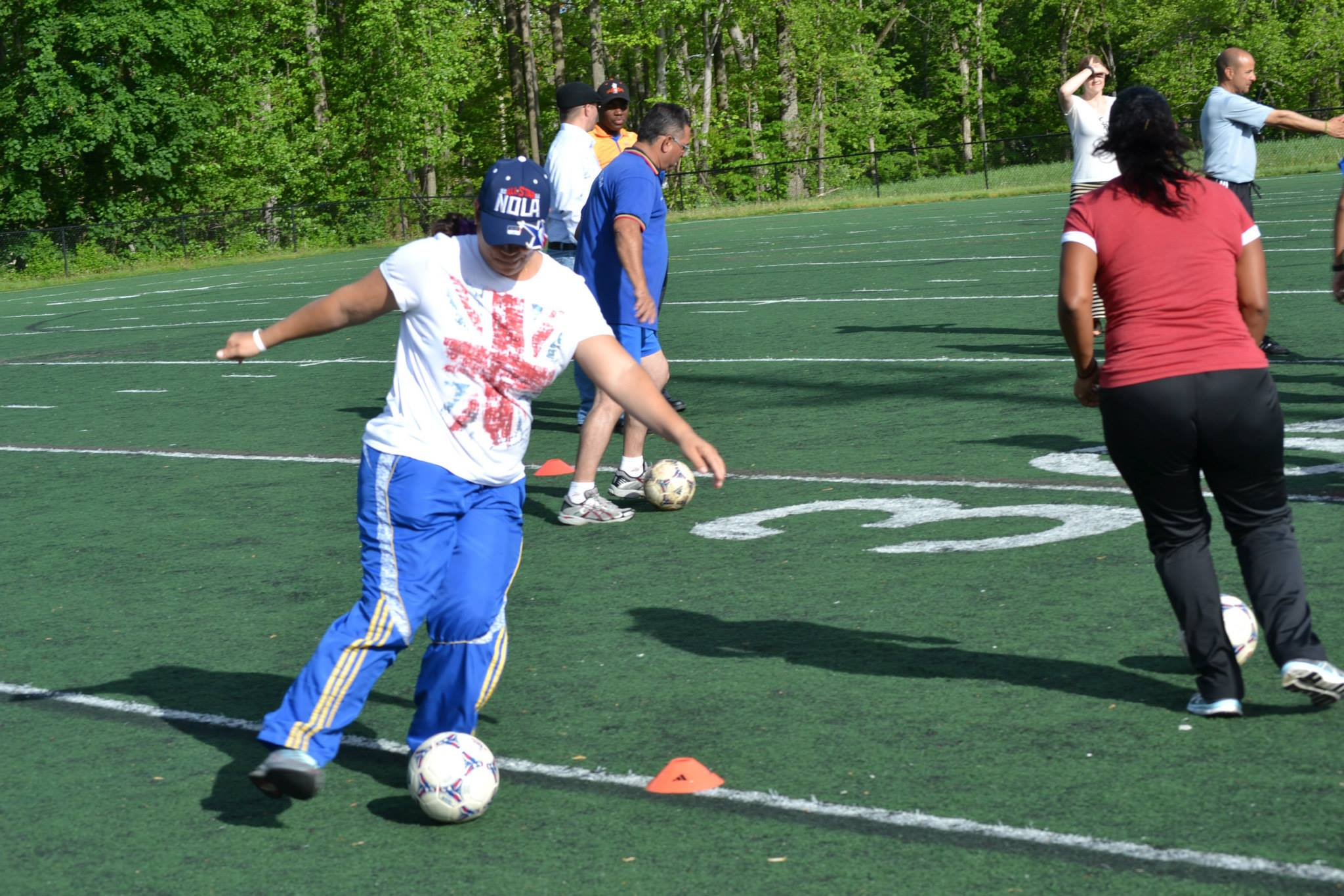 One of the participants practices her ball handling skills during a drill