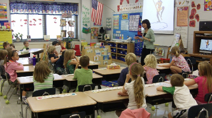 Li Shumeng taught at Cullowhee Valley School in North Carolina during the 2011-2012 school year. In this picture she is introducing the Chinese story of the Monkey King.