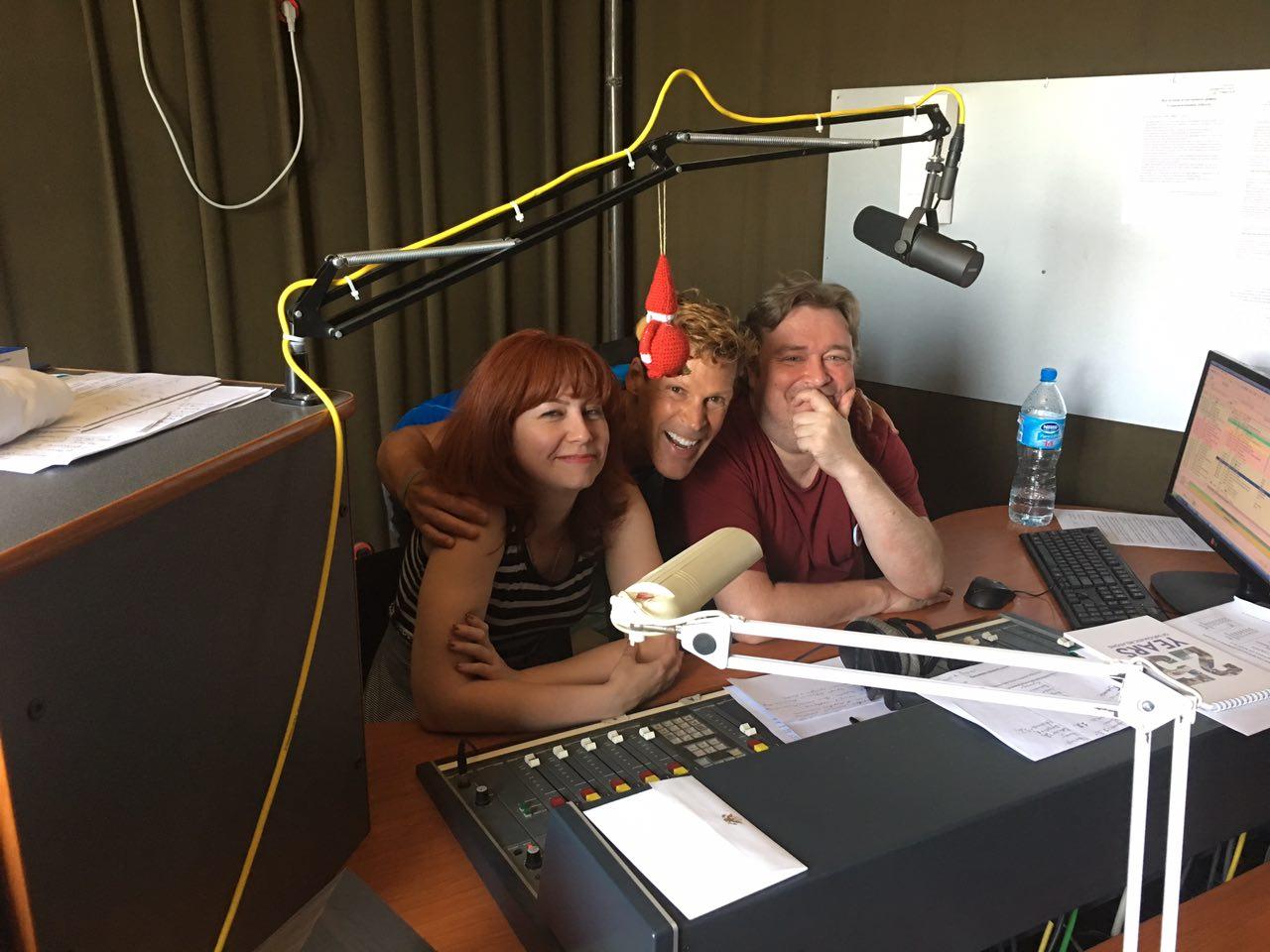 Dean behind the radio show microphone