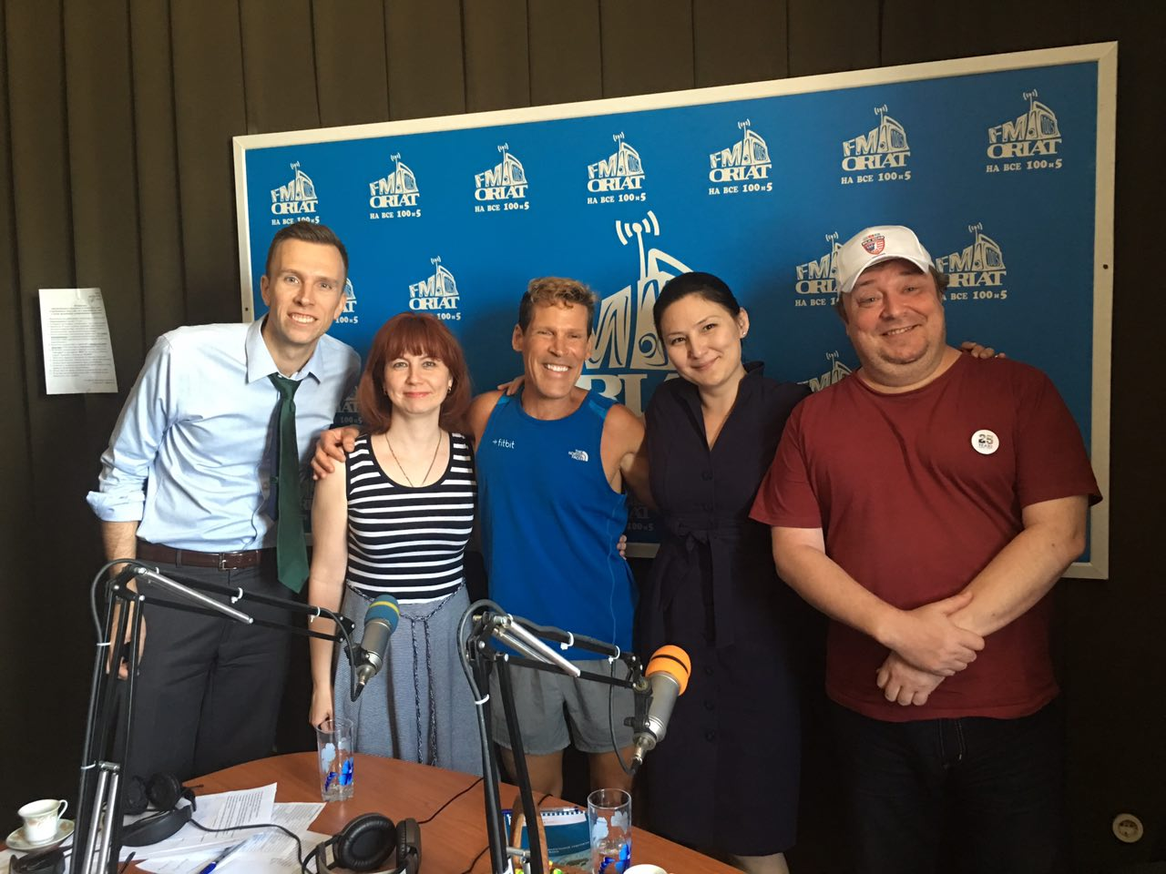 Dean Karnazes smiling with the radio crew