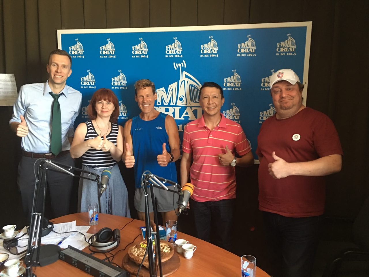 Dean and the radio crew give a thumbs up in this group photo