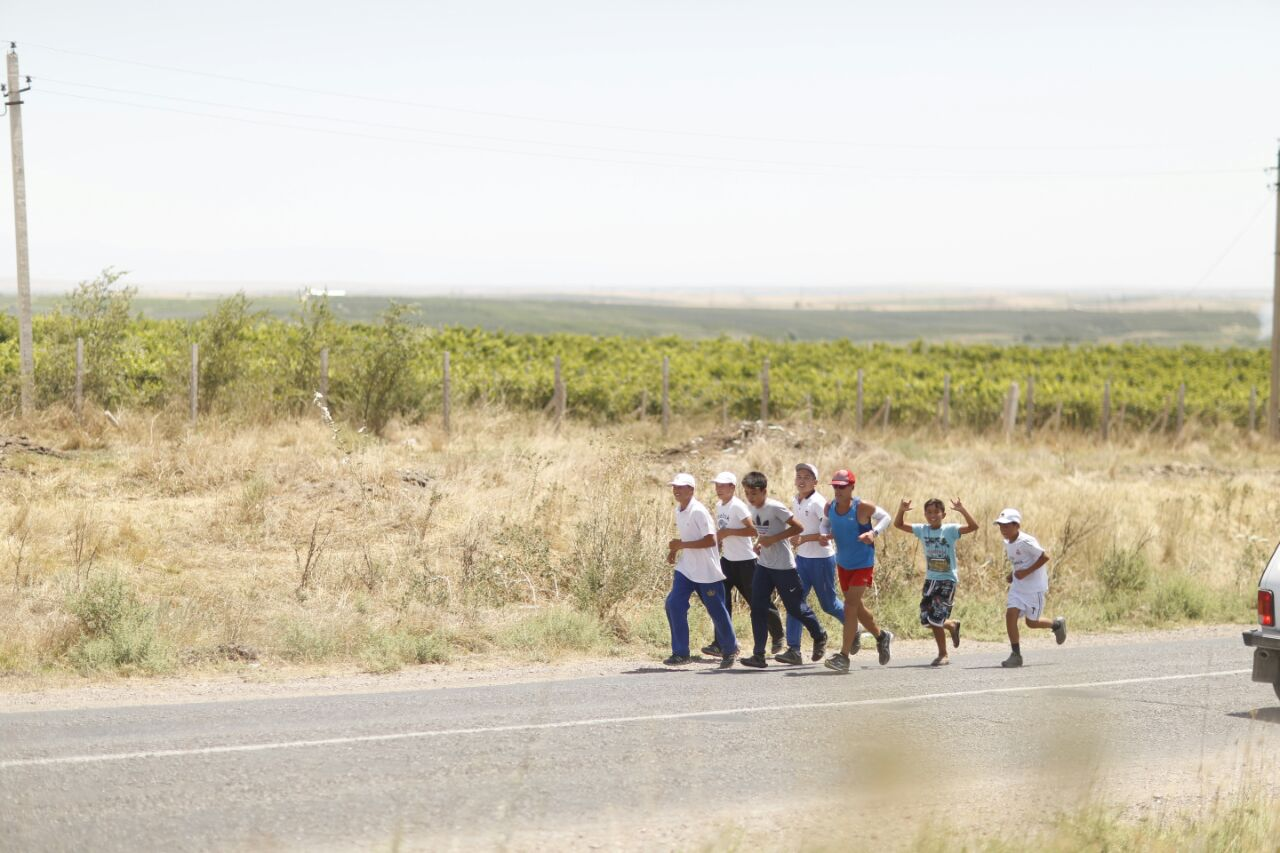 group running with Dean in countryside