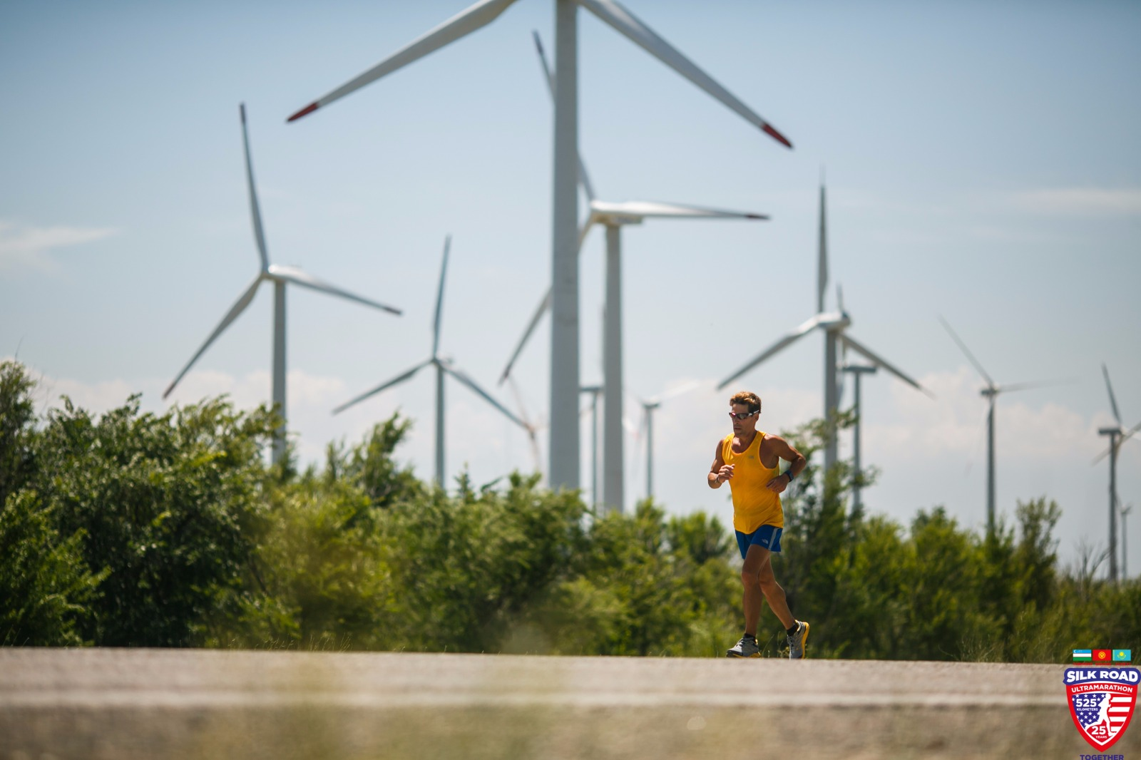 Dean running with wind turbines in the background