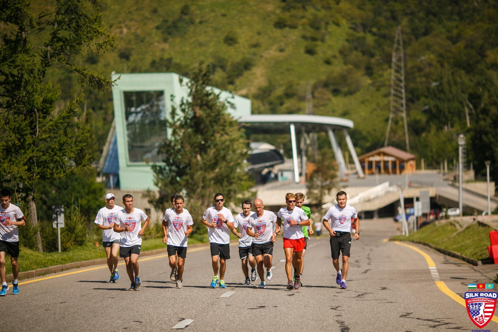 Dean running along highway through the mountains