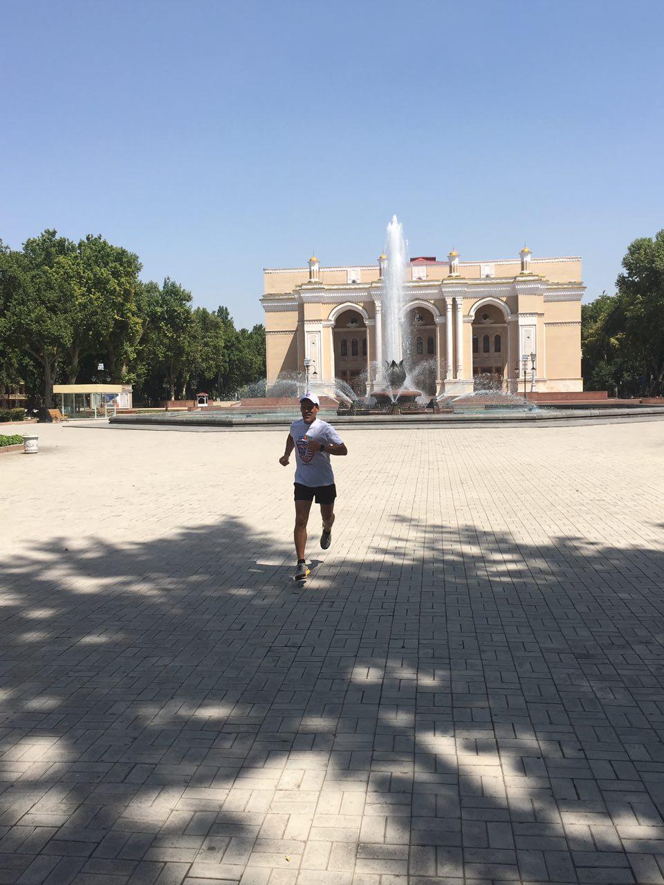 Dean Karnazes running in front historic opera house.