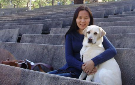 Fulbright Foreign Student alumna Uyanga Erdenebold with her seeing-eye dog, Gladys.