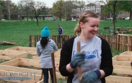 Fulbright Seminar participant, helping to create a community garden.