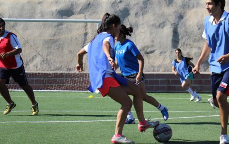 A soccer clinic engages a group of 12-14 year-olds from Lo Espejo, an economically-marginalized community outside of Santiago, Chile.