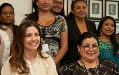 Assistant Secretary Ryan poses with the women in the program
