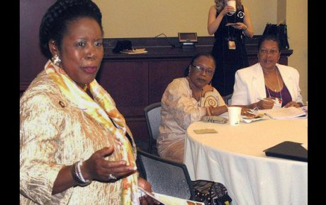 Mariama Sesay from Sierra Leone and Sylvianne Valmont from Seychelles listen to Representative Sheila Jackson Lee at the U.S. Capitol.