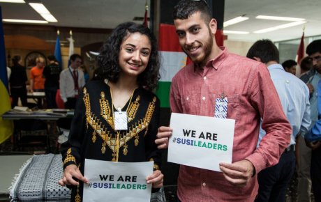 "Male and female participant holding signs that say ""We are SUSI leaders"""