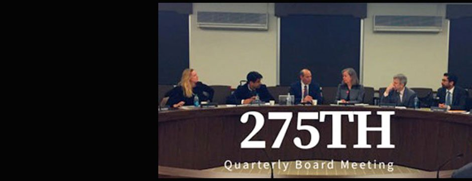 "Six adults sitting behind a long round desk with the title ""275th Quarterly Board Meeting"" layered on top"