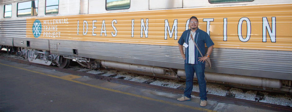 man standing next to train