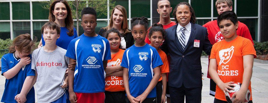 Cobi Jones and Evan Ryan with DC youth