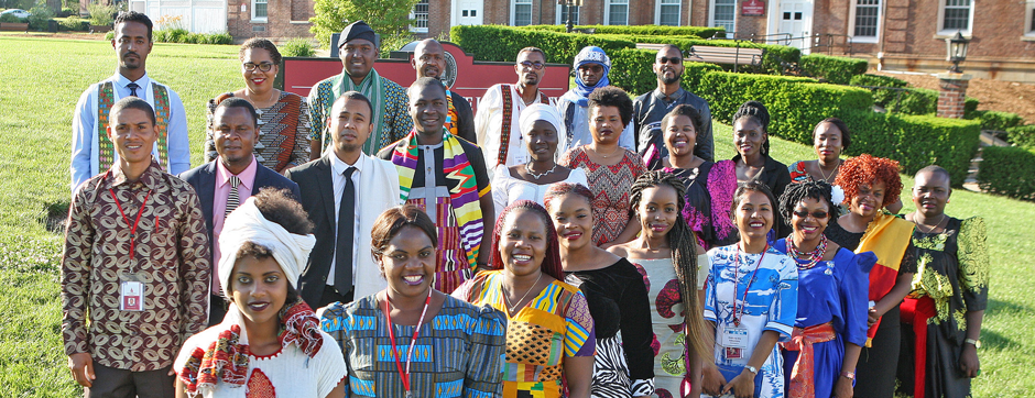 Large group of young black participants standing outside a college building