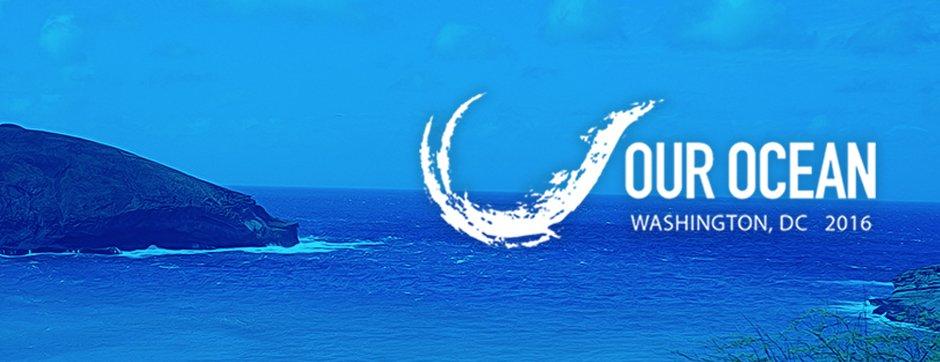 Our Ocean 2016 wave logo superimposed on a shoreline scene