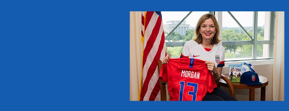 Assistant Secretary Marie Royce and Alex Morgan shirt