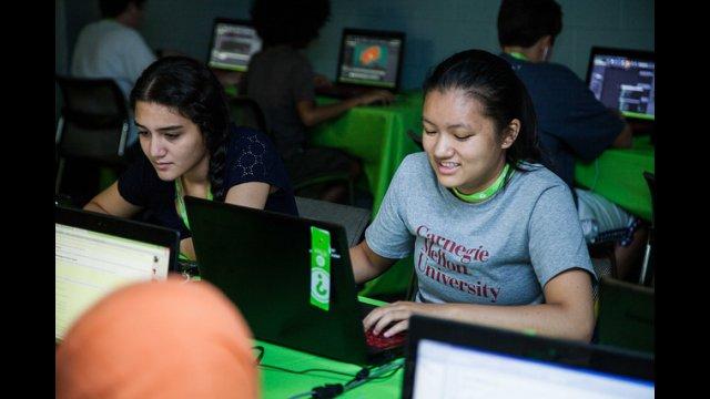 TechGirls Paricipants looking at computer