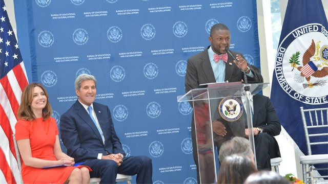 Young black man speaking at a State Department podium