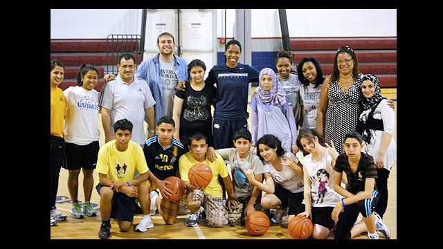 The Iraqi participants pose with Monica McNutt, Georgetown University basketball player.