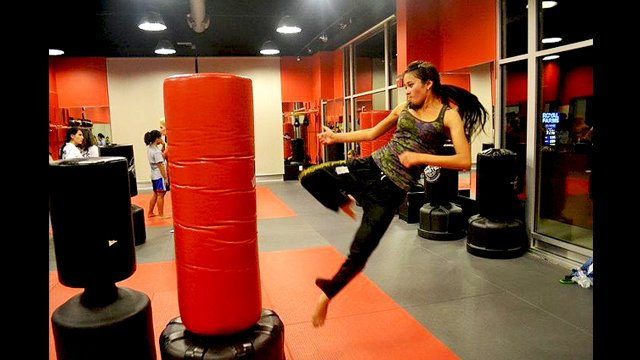 A Tajik coach practices her kick in one of the many training sessions.