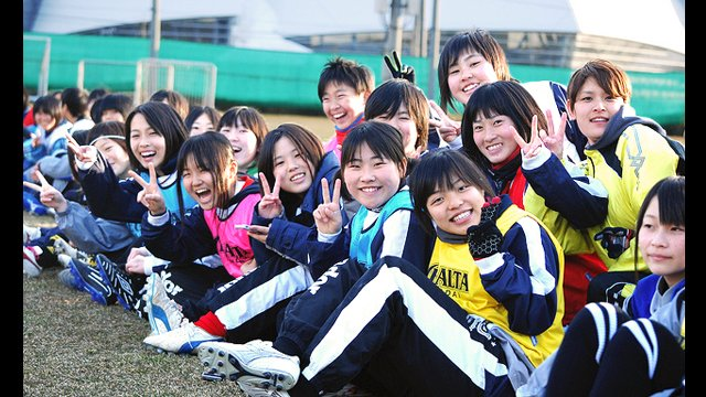 Young Japanese players watch the U.S. Women's National Soccer team practice at the Izumi Soccer Field in Sendai, Japan.